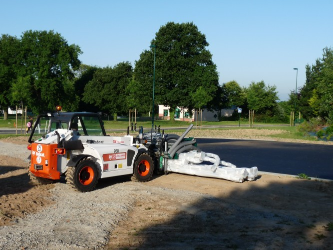 Acheminement du matériel pour la réalisation d'un terrain multisports